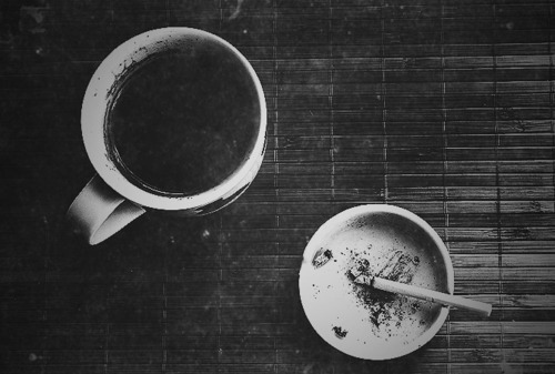 Black and white photo of coffee and cigarette